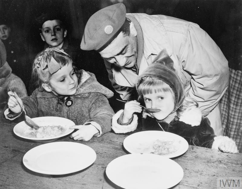 MEAL TIME AT UNITED NATIONS RELIEF AND REHABILITATION ADMINISTRATION CAMP, GREVEN, GERMANY, c 1946