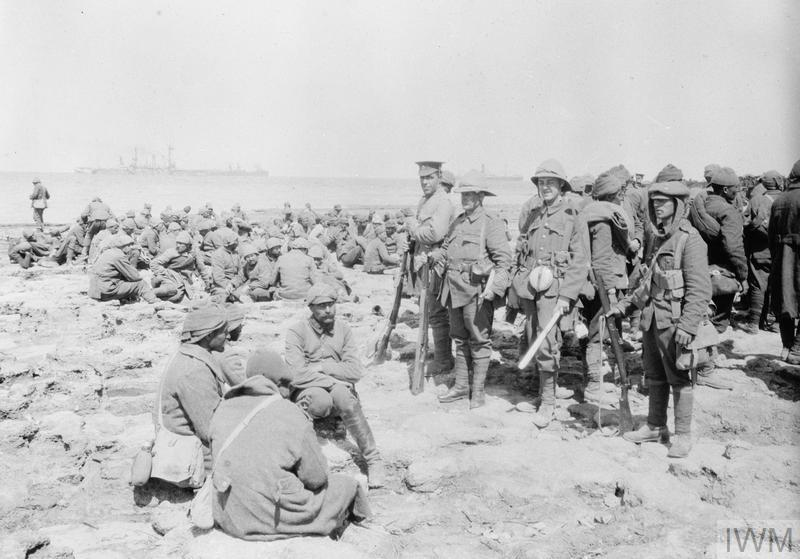 Turkish prisoners under guard on 'W' Beach, Cape Helles, Gallipoli.