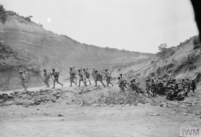 Soldiers of a Gurkha battalion of 29th (Indian) Brigade moving through Gully Ravine on 8 June 1915.