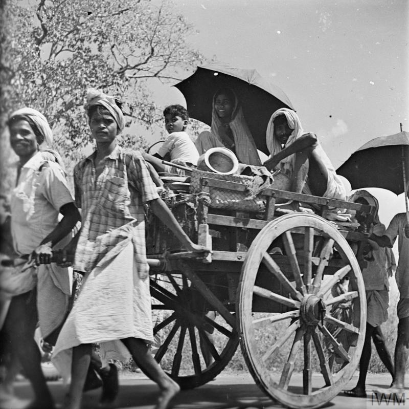 Civilians pulling a cart during the evacuation of Rangoon, 1942.