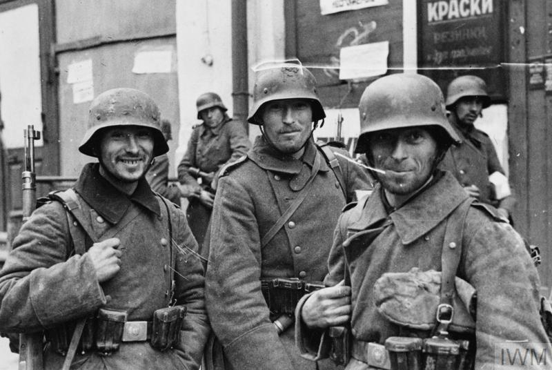 Portrait of three German soldiers in a Russian street.
