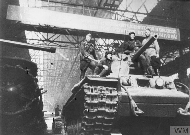 A tank crew takes a newly-built KV-1 tank out of a Soviet tank factory in the Urals.