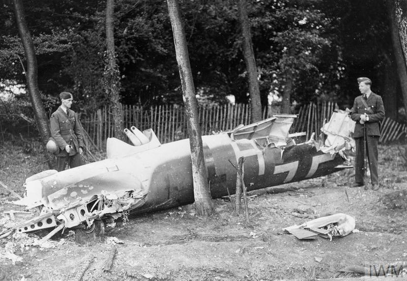 RAF aircraftman guard the remains of Dornier Do17Z-2 (F1+HT) shot down during the low-level attack on Kenley aerodrome, 18 August 1940. The aircraft crashed in Golf Road, Kenley at 1.20pm.