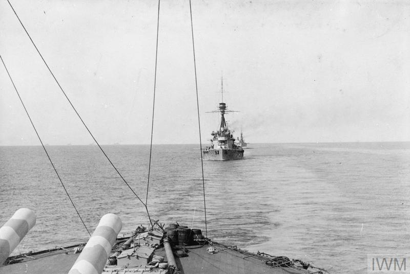 British battleships in line astern, viewed from HMS AGAMEMNON, going into action on 18 March 1915 in an attempt to force the Dardanelles. Battleships of the French Navy can be seen on the horizon.