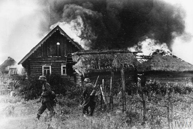 German troops occupy a burning Russian village during Operation Barbarossa, summer 1941.