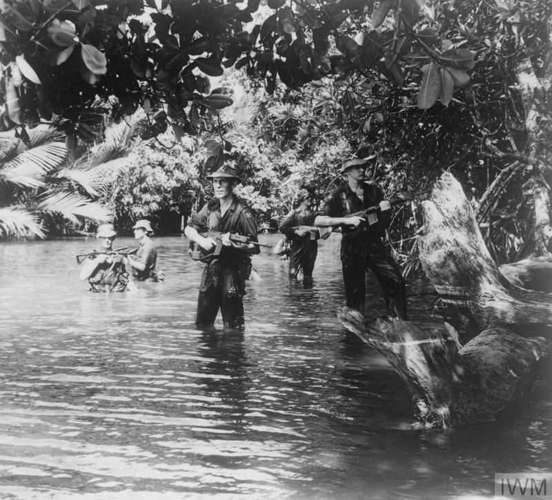 A patrol of the 1st Battalion, Queen's Own Highlanders (Seaforth and Camerons) searches for rebels in the jungle of Brunei, during the Indonesian Confrontation.