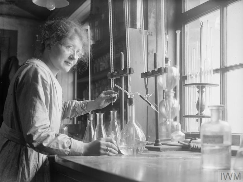 A female chemist in the laboratory of a cement works in Scotland, November 1918.