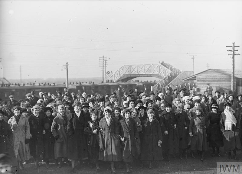 Munition workers arriving at the railway station after a night shift, Gretna Green.