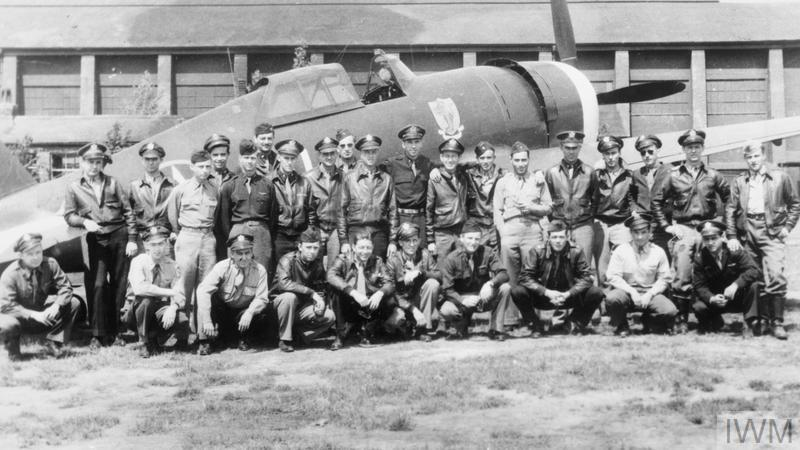 © IWM [HU 57978] - A group of pilots of the 83rd Fighter Squadron in front of Captain Charles P London's Republic P-47C Thunderbolt 41-6335, HL-B, 'El Jeepo' in April 1943.