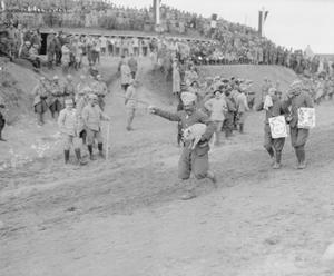 A pet pig being carried in a pageant arranged by the Regiment de Marche d'Afrique at Salonika, February 1916. THE MACEDONIAN CAMPAIGN, 1915-1918