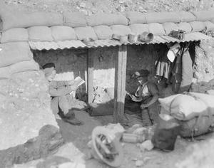 Two British soldiers resting in their dugout, Struma Front, November, 1916.