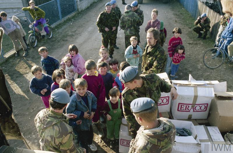 Members of the 1st battalion Royal Gloucestershire, Berkshire and Wiltshire Regiment distributing aid in the village of Glavice, South East of Bugojno.