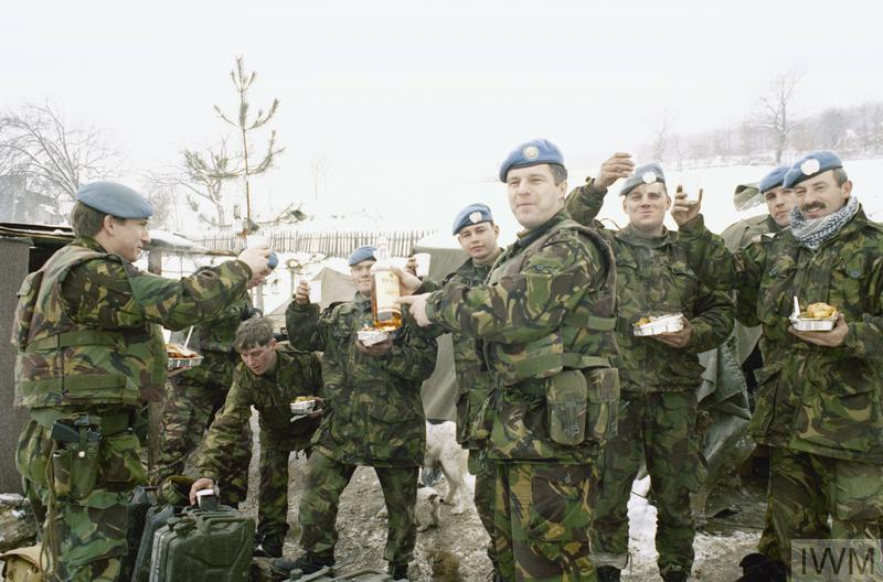 'B' Company, 1st battalion Royal Highland Fusiliers on Christmas day. Major David Crumlish has a whiskey with the men at BM7. Taken at a checkpoint in the Vitez area.