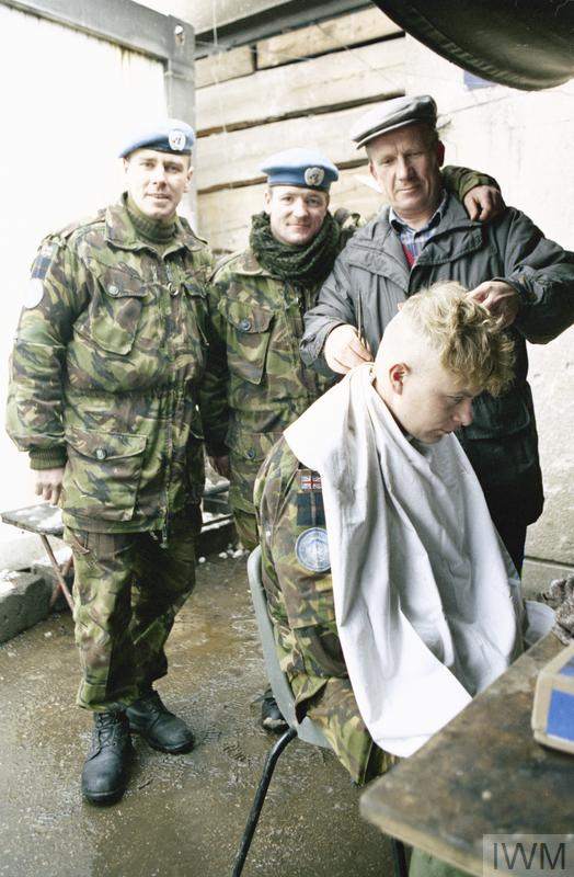 Local man acts at the hairdresser for men of 'B' company 1st battalion Royal Highland Fusiliers. Probably Vitez area.
