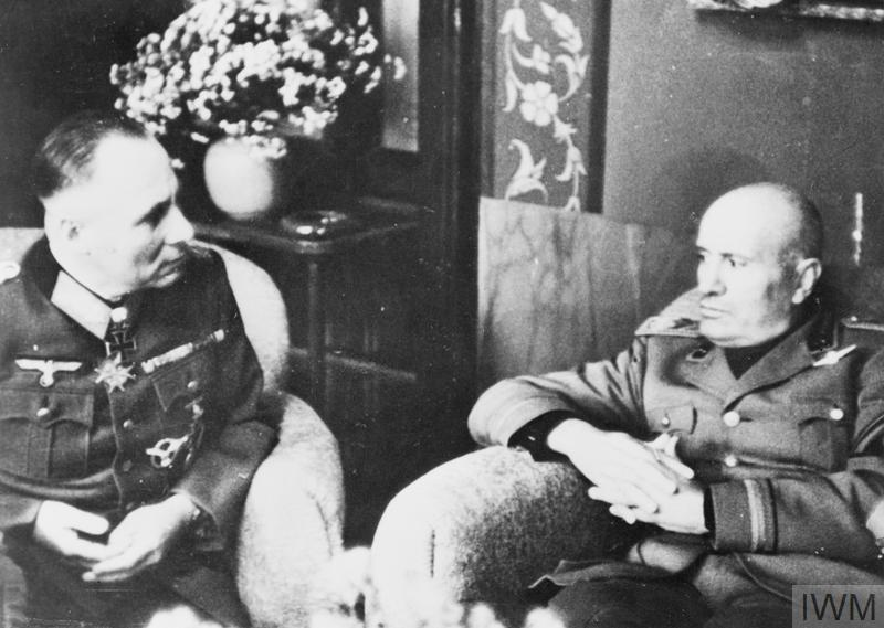 (© IWM HU3061) Decline 1943 - 1945: Mussolini in conversation with Field Marshal Rommel at the Italian Government Headquarters. Both men were by this time out of favour with Hitler.