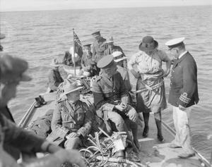 Souvenir hunters, including a Canadian nursing sister, returning from a visit to the wreckage of German Zeppelin LZ.85 in the marshes at the mouth of the River Vardar on 6 May 1916, the day after the airship was brought down by gunfire from HMS AGAMEMNON. THE MACEDONIAN CAMPAIGN, 1915-1918