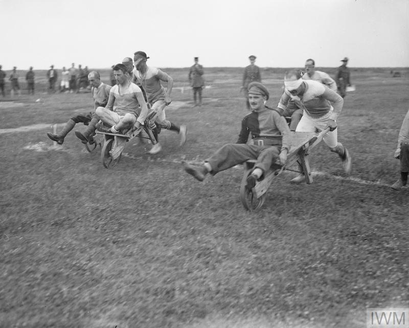 British troops competing in a wheelbarrow race.