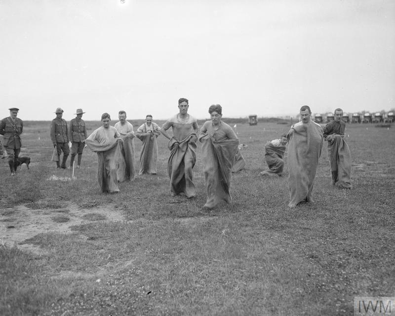 British troops competing in a sack race.