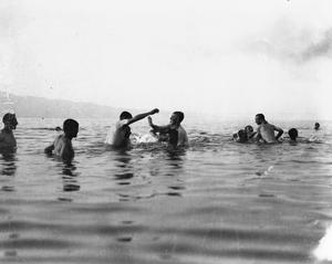 At Stavros the sea bathing is excellent and thousands of soldiers enjoyed a swim morning and evening. A wrestling match in the water. 27th Division, July 1916.