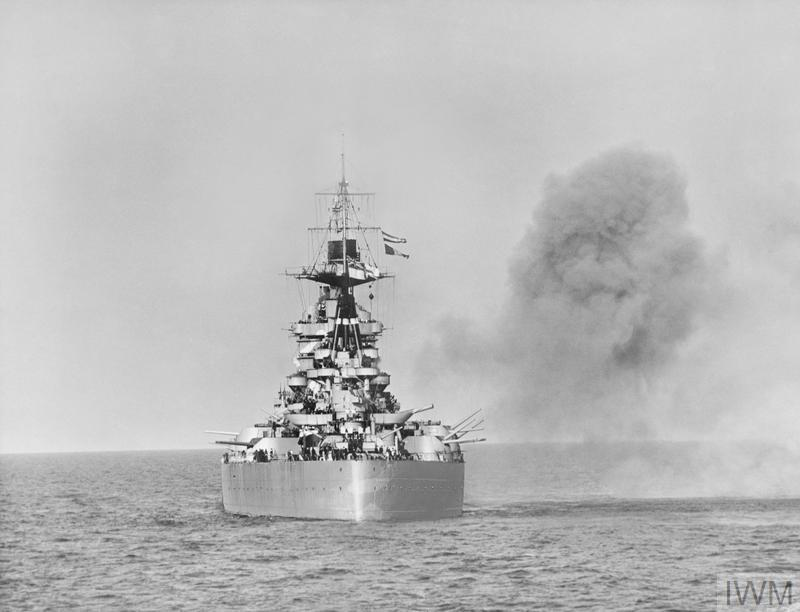 HMS RODNEY adds her weight of shells to the Navy's pounding of enemy positions along the Caen coast in support of the D-Day landings.