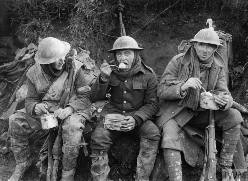 British soldiers eat hot rations in the Ancre Valley during the Battle of the Somme.