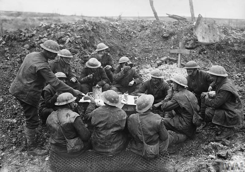 British troops eat their Christmas dinner in a shell hole at Beaumont Hamel on the Somme