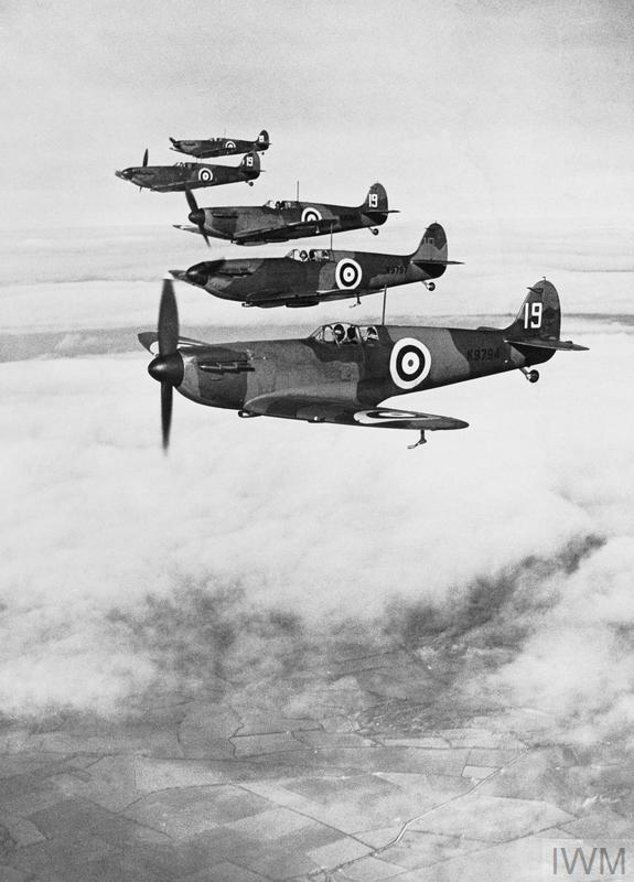 Six Spitfire Mark Is flying in starboard echelon formation
