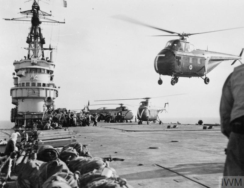 Westland Whirlwind helicopters of the Royal Navy taking the first men of 45 Royal Marine Commando into action at Port Said from HMS THESEUS.