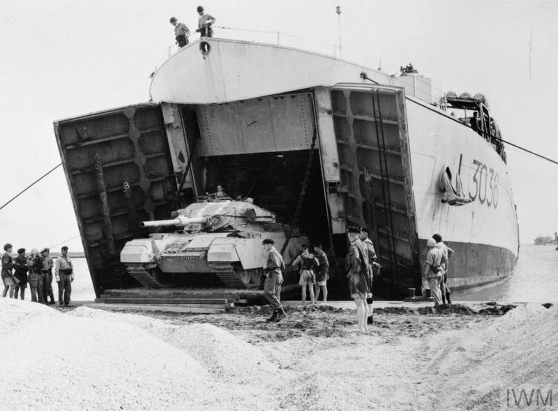 A tank of the 6th Royal Tank Regiment leaving a Royal Navy Tank Landing Ship at Port Said.