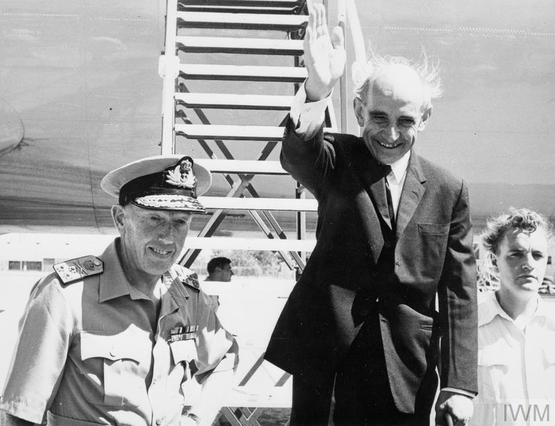 The departure of the High Commissioner of Aden, Sir Humphrey Trevelyan, from Khormaksar on 28 November 1967. The Commander-in-Chief in the Middle East, Admiral Le Fanu, is seen in the foreground.