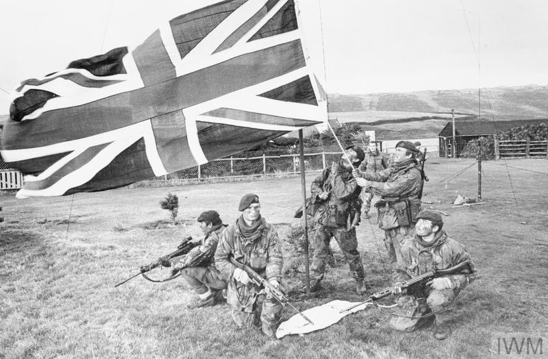 Marines of 40 Royal Marine Commando raise the British flag on West Falkland after the Argentine surrender.