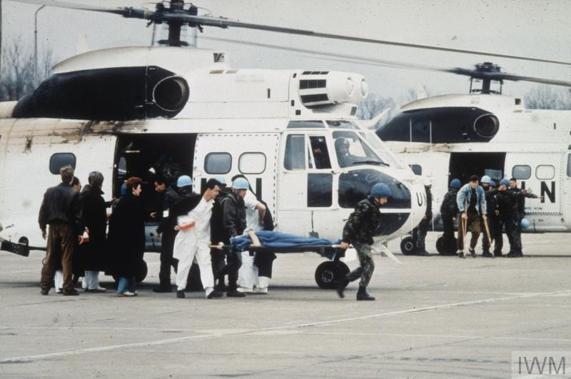 Casualties arrive by United Nations helicopter at Tuzla airfield following their evacuation from Srebrenitza.