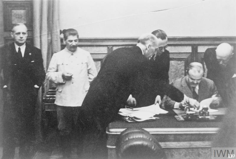 The Russo-German Non-Aggression Pact is signed by Vyacheslav Molotov, the Soviet Foreign Minister, under the watchful eye of Joseph Stalin. Left to right: Joachim von Ribbentrop, the German Foreign Minister; Joseph Stalin; Junior Secretary of State Gauss; the German Legation Councillor, Gustav Hilger; and German Ambassador to Moscow, Friedrich von der Schulenburg. The pact was in reality the agreement of partition of Europe between two countries.