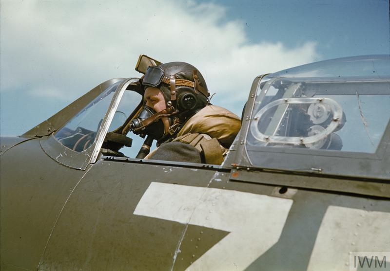 A pilot in the cockpit of a Spitfire