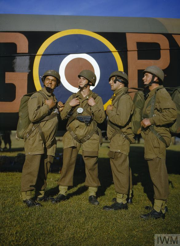 Men of the Airborne Division adjusting their harness alongside Armstrong Whitworth Whitley `PX-G' of No 295 Squadron, Royal Air Force.