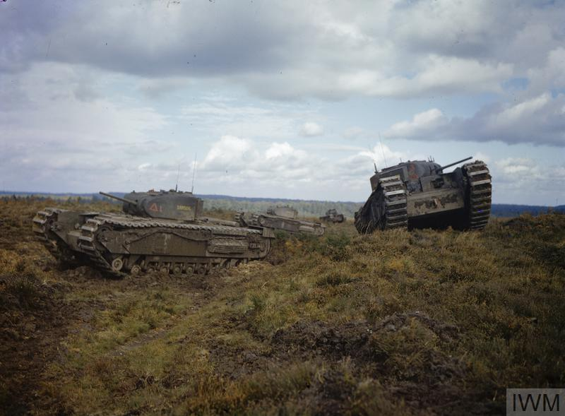 Churchill tanks of A and B Squadrons, 43rd Battalion, Royal Tank Regiment, 33rd Brigade negotiating obstacles.