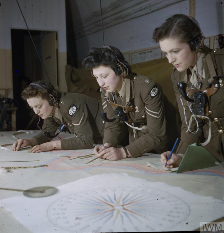 Three Auxiliary Territorial Service plotters at a plotting table, Headquarters of 428 Battery, Coast Defence Artillery