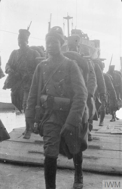 French Senegalese troops landing: SS RIVER CLYDE in the background: Gallipoli, May 1915.