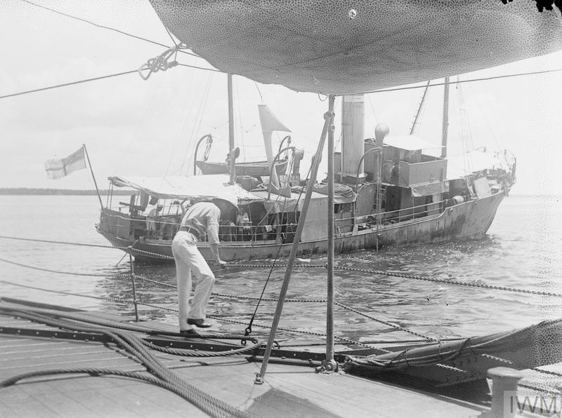 """British Monitor """"Severn"""" endeavouring to tow the Whaler """"Rattler"""" which went aground near Wasin Island 24th February 1916."""