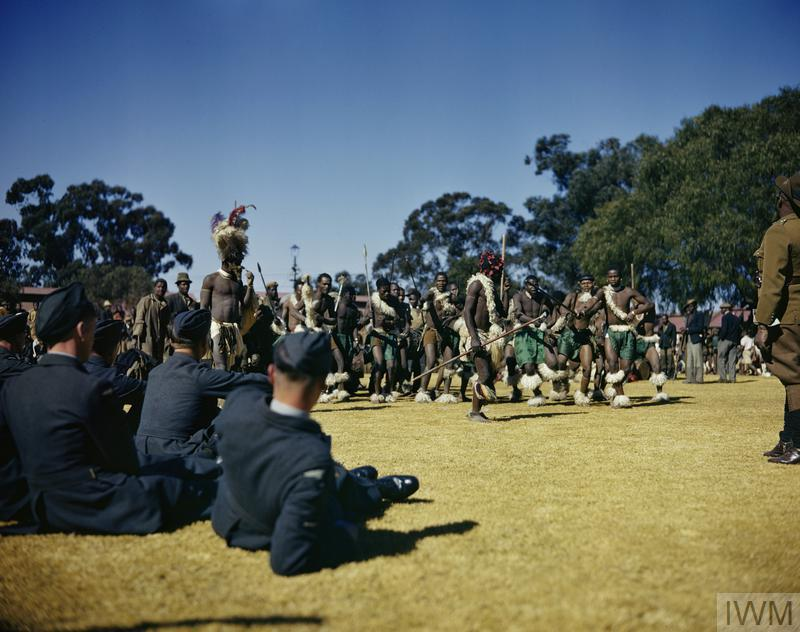 RAF cadets watching a Zulu war dance at Rose Deep Mine, Johannesburg.