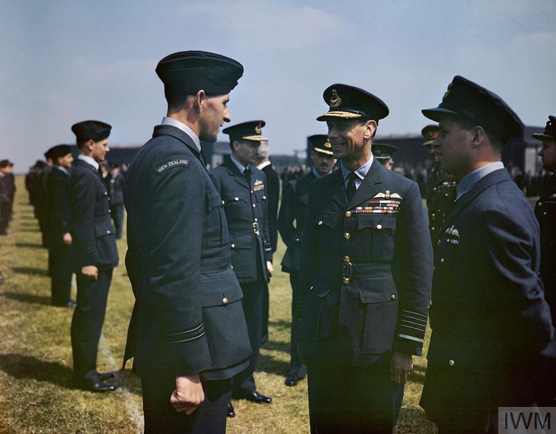The King has a word with Flight Lieutenant Les Munro from New Zealand. Wing Commander Guy Gibson is on the right and Air Vice Marshal Ralph Cochrane, Commander of No 5 Group is behind Flight Lieutenant Munro and to the right.