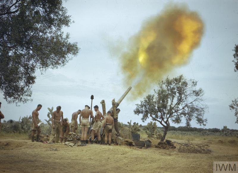 Soldiers of the Eighth Army in Tunisia fire a 4.5-inch gun four miles from the enemy lines.