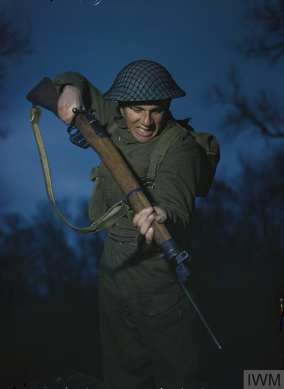 Private A Campin with fixed bayonet, practises assault.