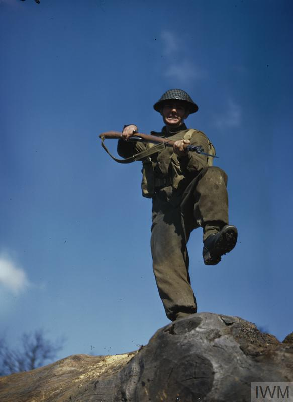 Private T Henderson practices an assault with a fixed bayonet during training.