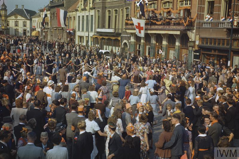 Civilians dancing in the square of Eindhoven, the first major town in Holland to be liberated. Eindhoven was later bombed by the German Air Force.