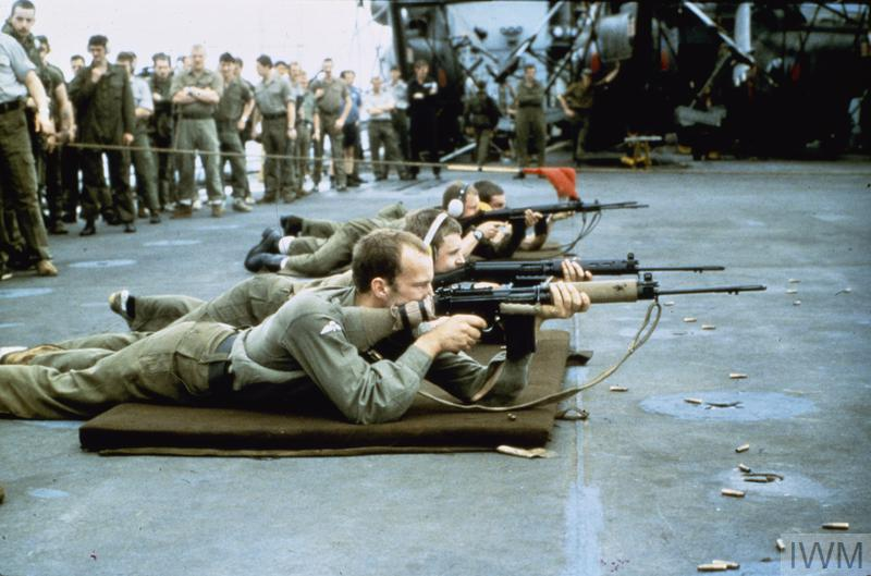 Weapons training for members of the Royal Marines during the voyage to the South Atlantic, 1982.