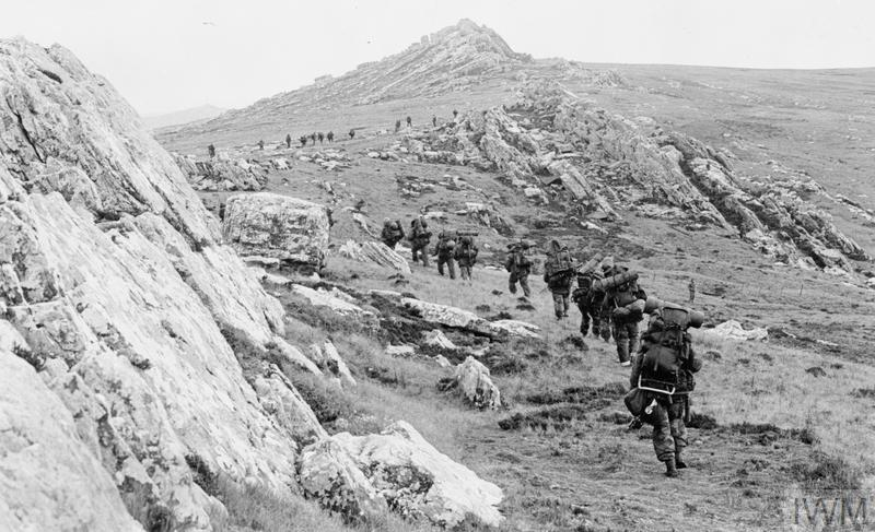 42 Commando, Royal Marines, moves off Mount Harriet during the mountain battles.
