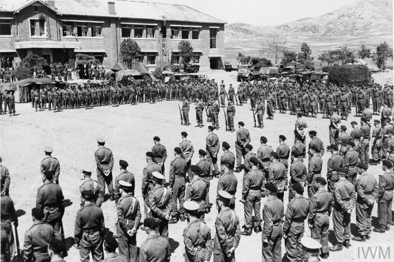 Representatives of United Kingdom, Canadian, Australian and Belgian units of the British 29th Brigade stand at Parade Rest, during ceremonies in which the American Presidential Unit Citation was awarded to the Gloucestershire Regiment and the 170th Independent Mortar Battalion, Royal Artillery for a heroic and sacrificial stand against encircling Chinese, 23-25 April 1951.