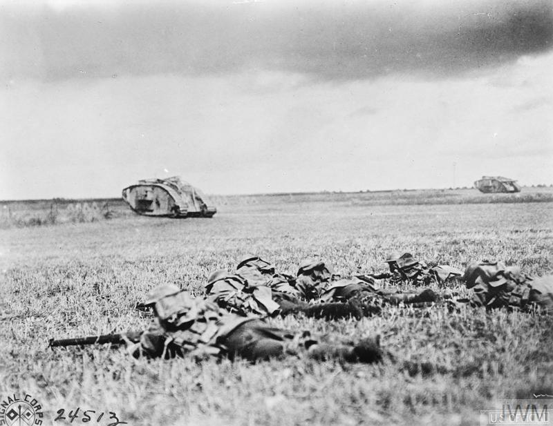 Troops of the 107th Infantry Regiment, American 27th Division following tanks near Beauquesnes, 13 September 1918. © IWM (Q 57694)