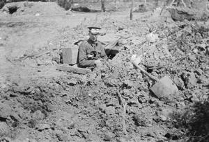 A British signaller in a dugout with the first issue of respirator at Ypres, May 1915. THE SECOND BATTLE OF YPRES, APRIL-MAY 1915